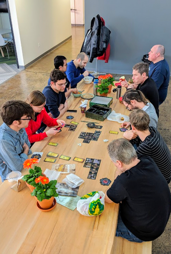 Alert labs staff playing several board games over lunch