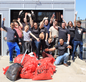Alert Labs team posing with bags of trash collected during Earth day clean up