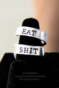 EAT SHIT banner ring