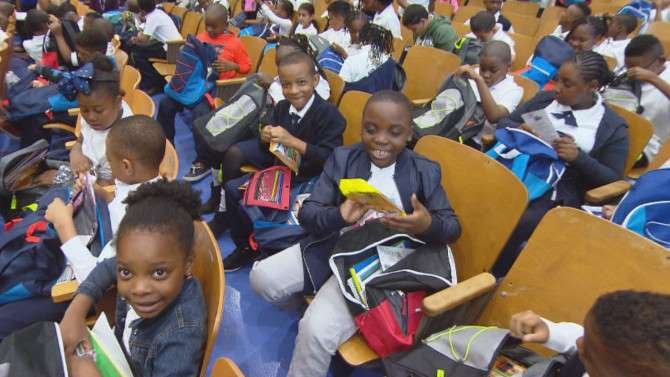 600 Students Surprised With Backpacks Full of Supplies for New School Year