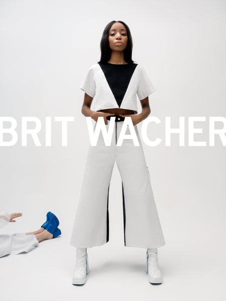 Brit Wacher's latest high-waisted white two-tone organic denim wide-leg trouser jean pants with cargo pockets.