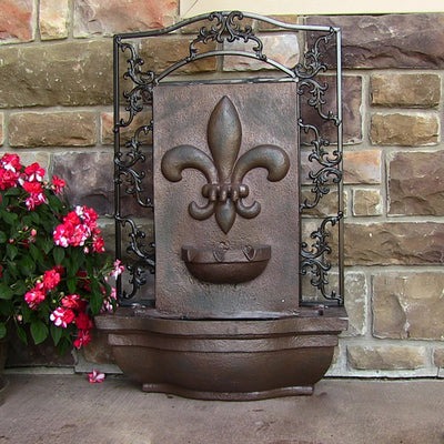 Sunnydaze French Lily Outdoor Wall Fountain - Weathered Iron - On Floor