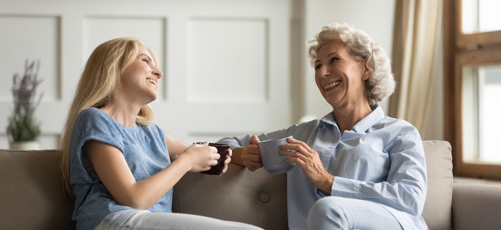 mother and daughter talking and laughing