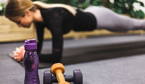 Woman working out with caffeine capsules