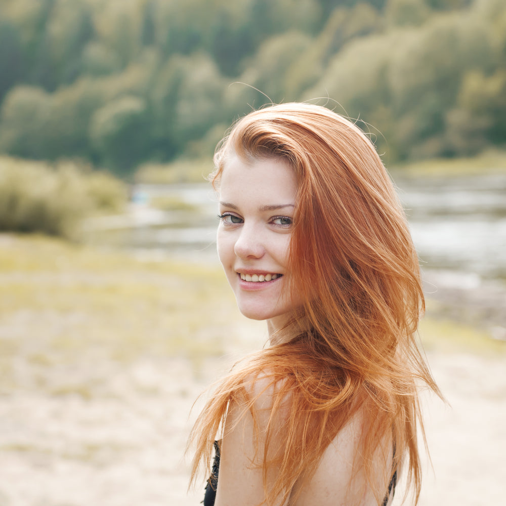 Red head woman smiling at the camera