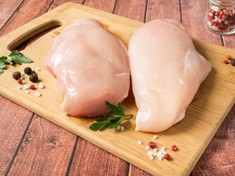 Two Chicken Breast on a cutting board