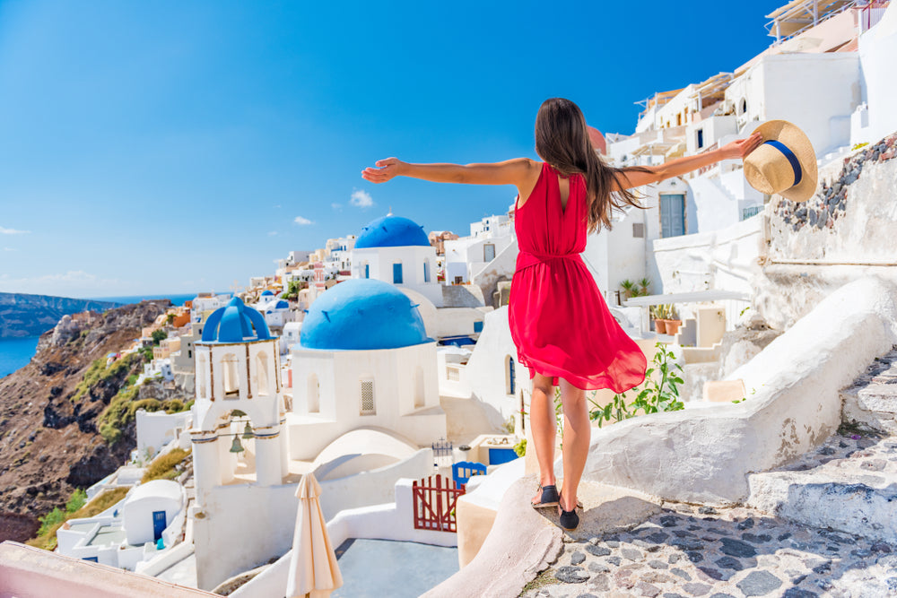 Women in red dress in Oia village, Santorini