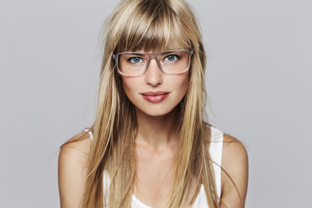 Blond woman with transparent glasses.