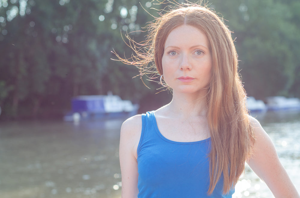 Red head woman in a blue tanktop