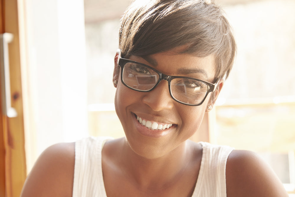 woman in glasses with short hair