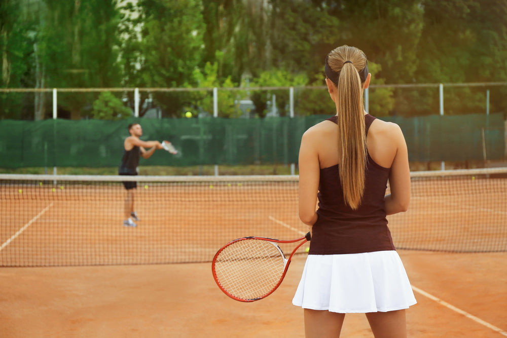 man and woman plaing tennis