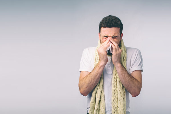 Man with flu cleans nose