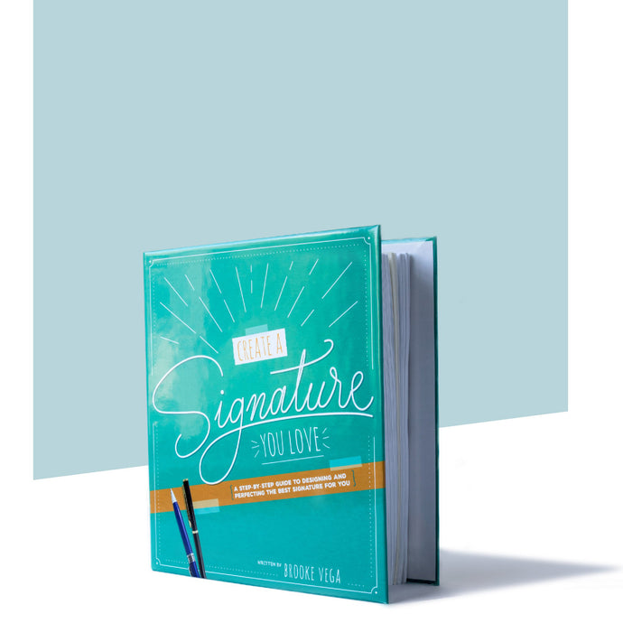 Image of the hardcover binder of the practice guide and workbook for Create a Signature You Love
