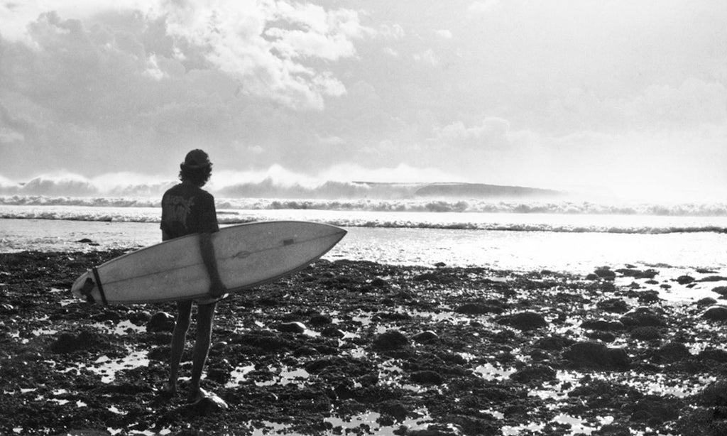 William Finnegan ponders the paddle, Grajagan, Java, 1978