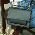 Zoe Mini Accordion Sling in Black (Vegan Leather)