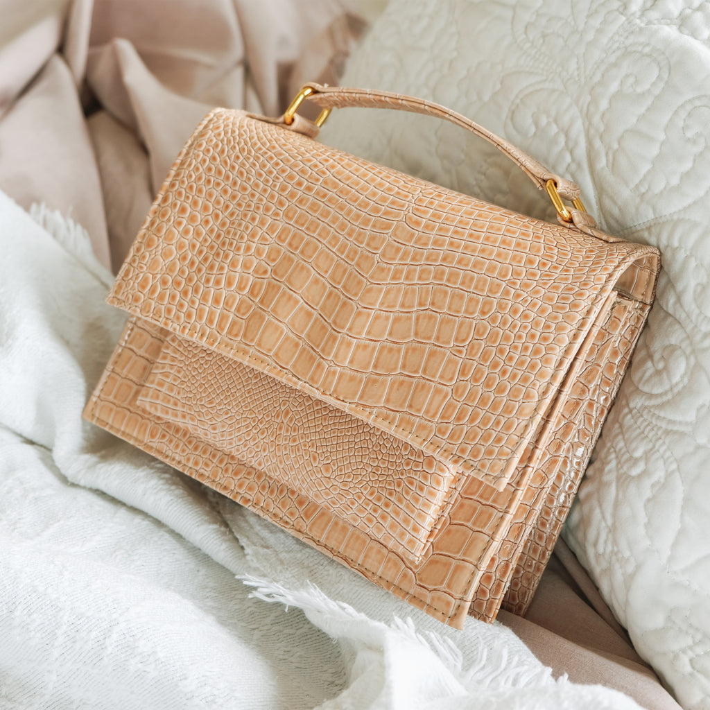Zoe Mini Accordion Sling in Nude (Faux Croc)