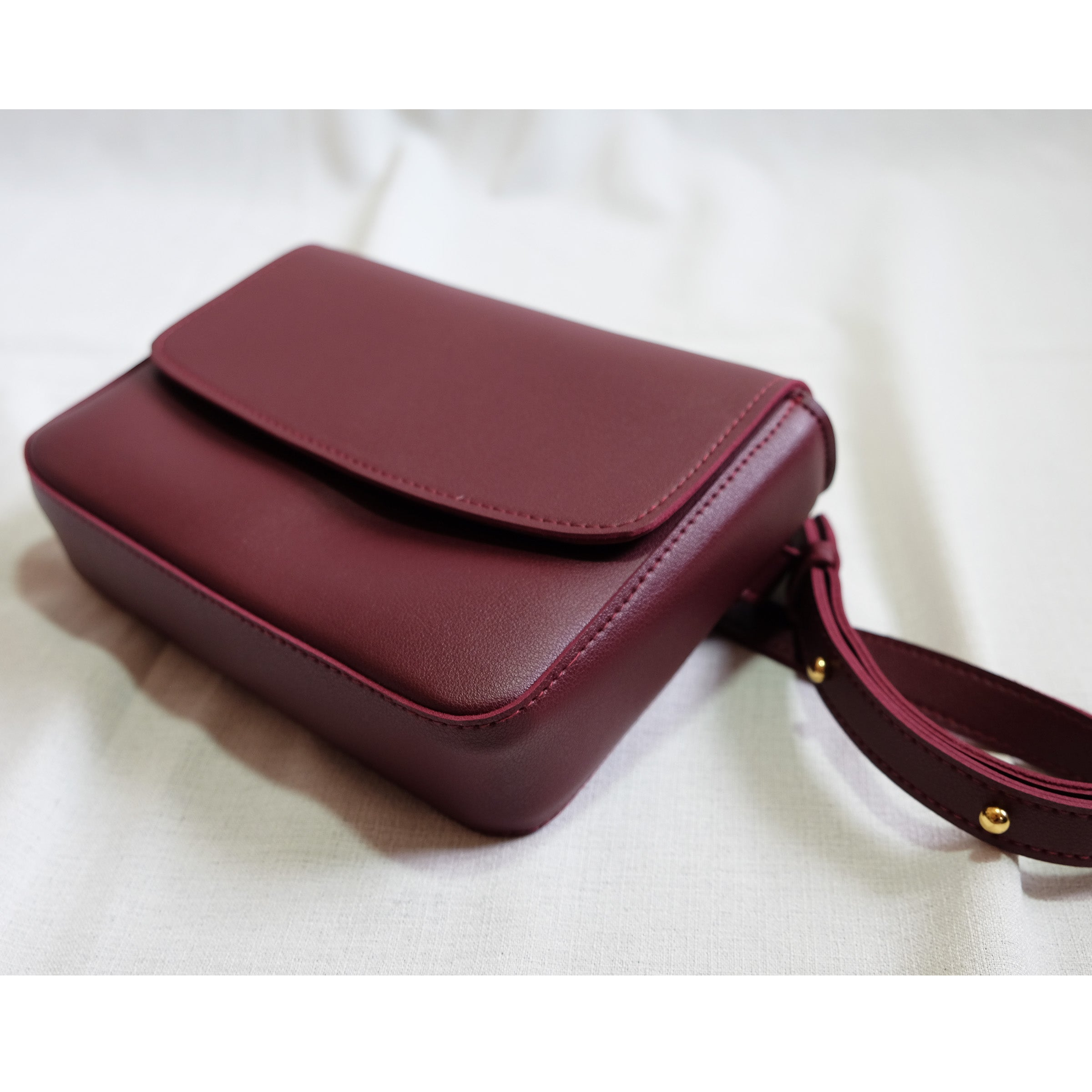 Astraea Convertible Sling in Wine