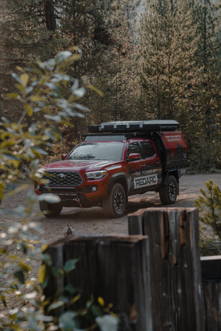 REDARC's ultimate off grid Tacoma build driving in the forest