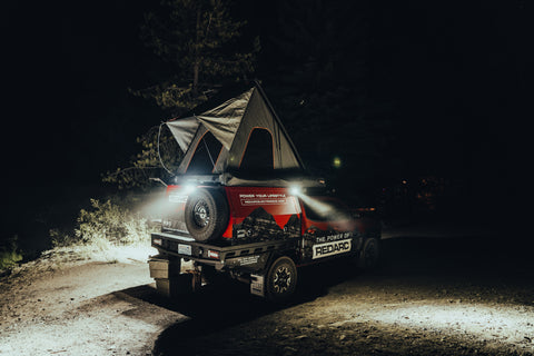 Lit up at night, the Tacoma is ready for camping