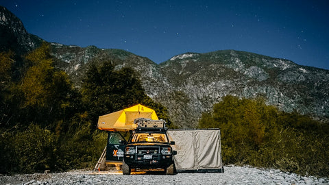 off-grid camping in the middle of the mountains with a rooftop tent