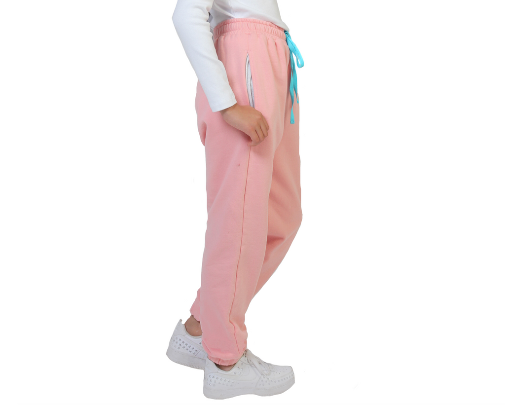 Teenage girl track pants in unbrushed fleece contrast pink