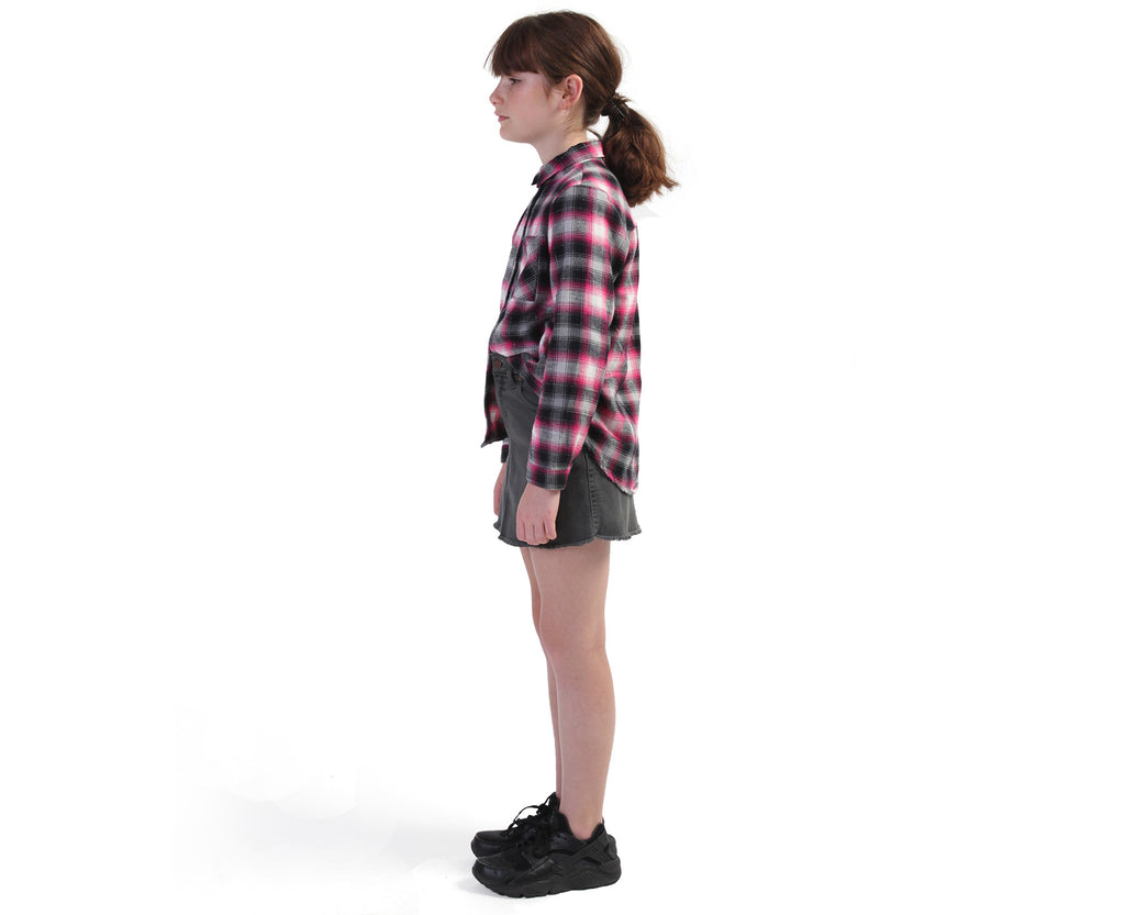 Young Girl wearing a check flannelette shirt in pink