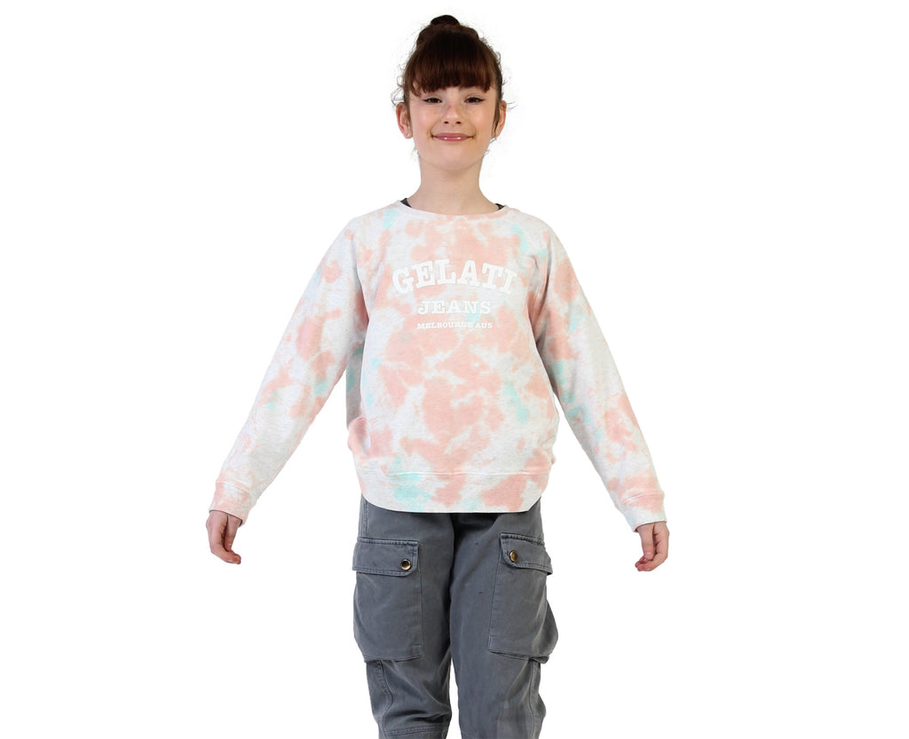teen young girl wearing tie dye peach pink printed sweater