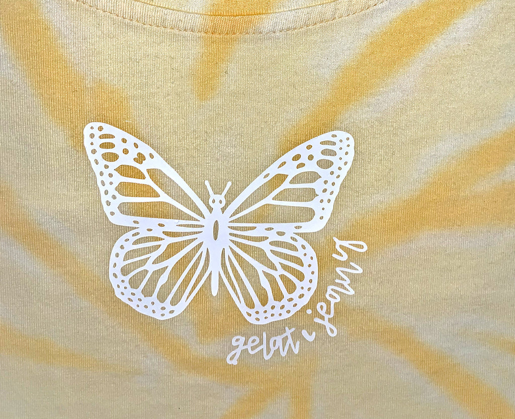 white butterfly graphic print on yellow tie dye crop tee for teens