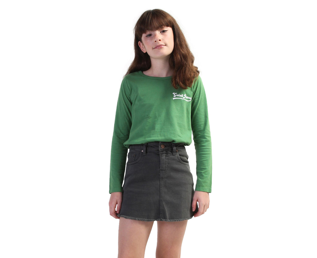 Teen girl wearing green baseball inspired long sleeve shirt