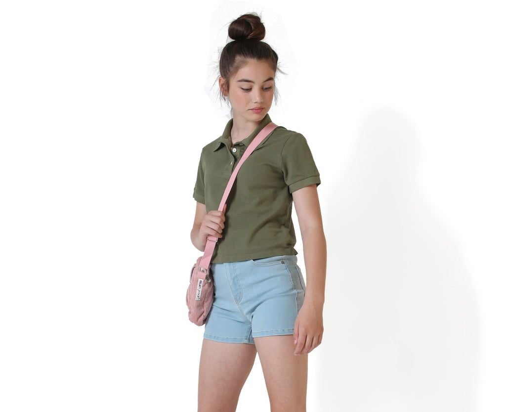 teenage girl wearing khaki polo top