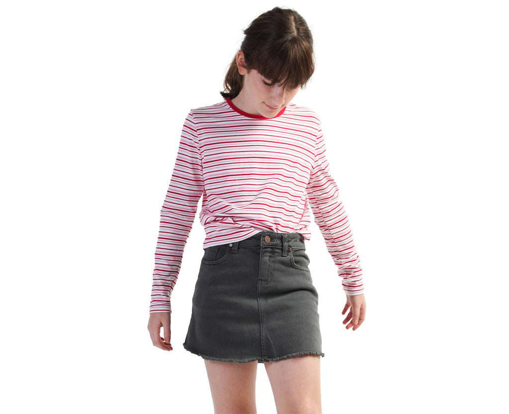 Young girl wearing striped long sleeve tee in pink and red