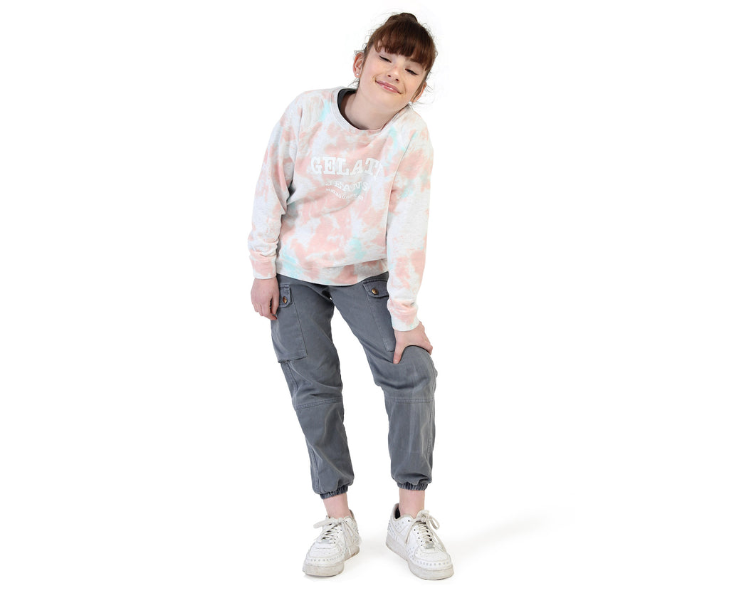 young girl wearing large tie dyed blotted pink printed jumper