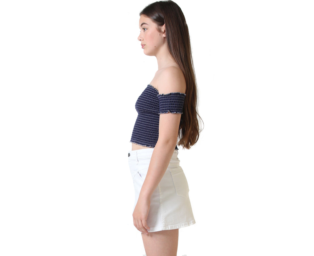Teen girl wearing white denim skirt