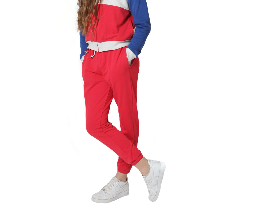 teen girl red tracksuit pants