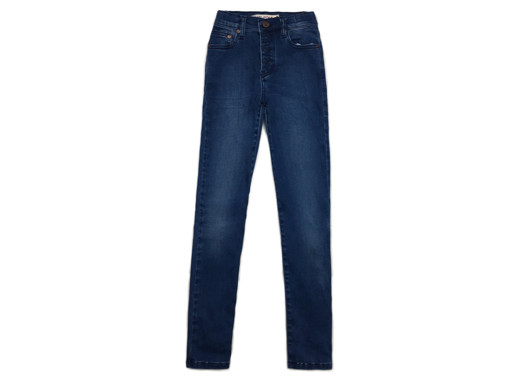 teenage girl high waisted skinny jeans in mid wash denim