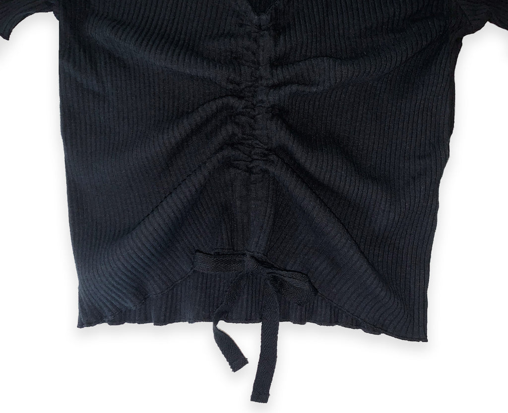 Detail of front drawstring on black ribbed youth top