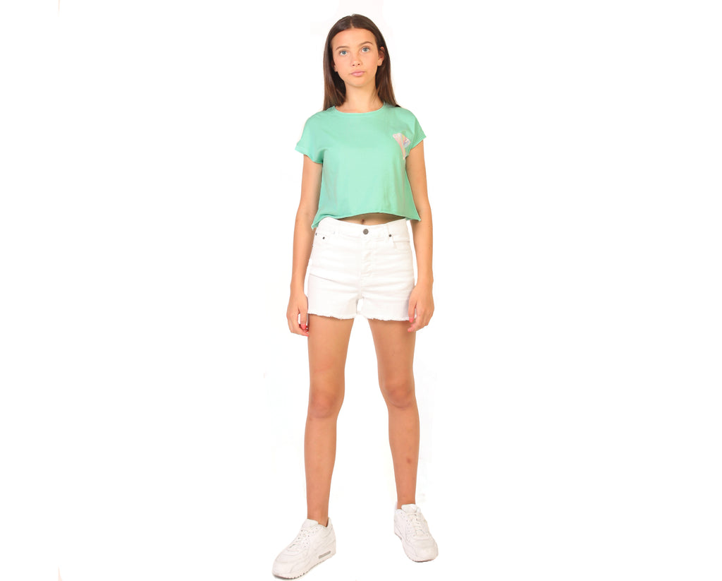 teenage girl wearing bright green crop t-shirt with rainbow graphic print