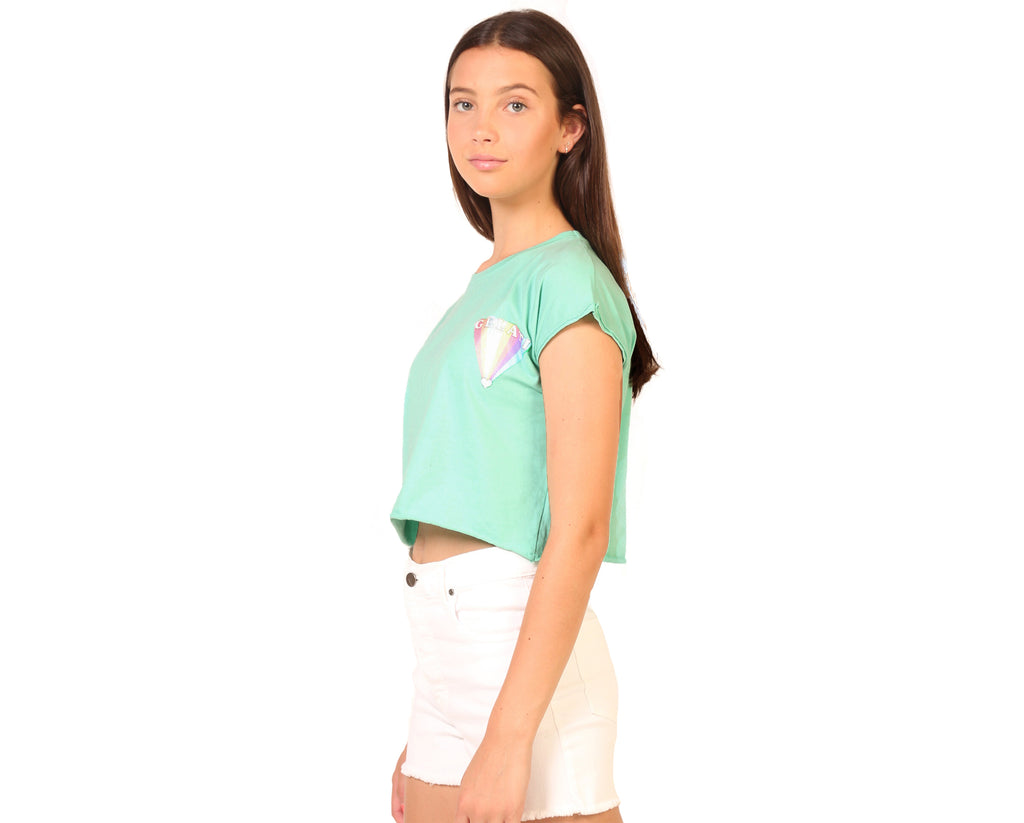 teen girl in mint crop tshirt with small rainbow print detail