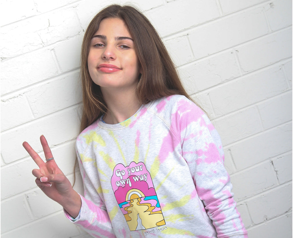 teenage girl wearing yellow and pink tie dye jumper
