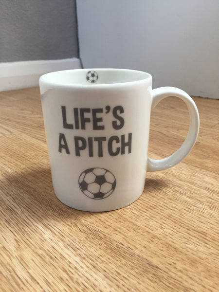 Life's A Pitch Football Mug
