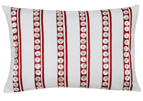 White buttons on red stripes cushion