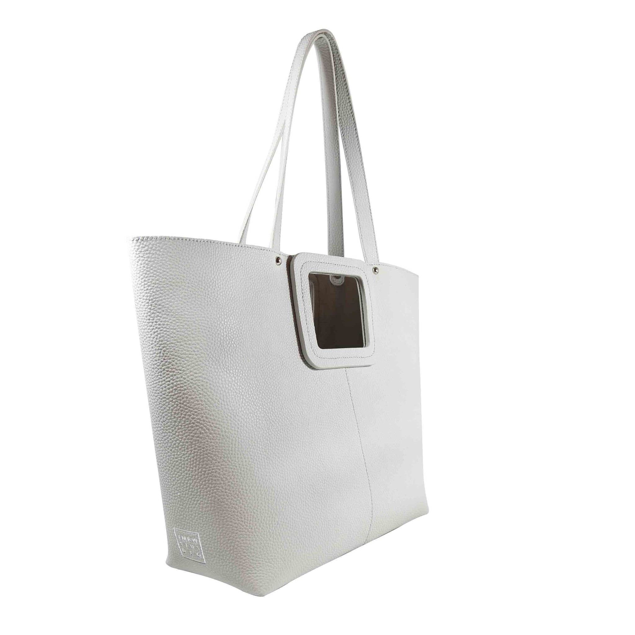 A dove/light grey large exclusive square point tote bag Included a detachable inner pouch Pebble cow leather Microsuede lining
