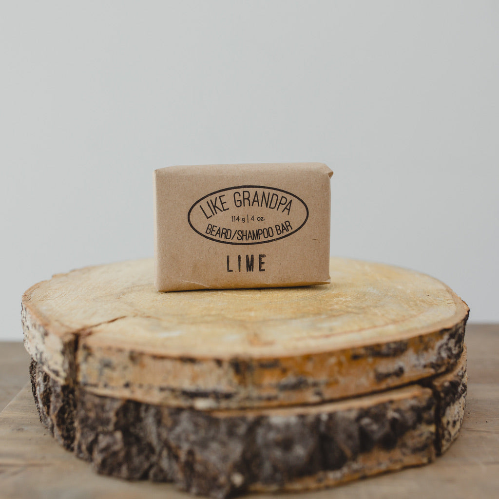 Lime Shampoo Bar wrapped in brown paper.