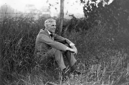 Henry Ford Sits In A Grass Field (1919)