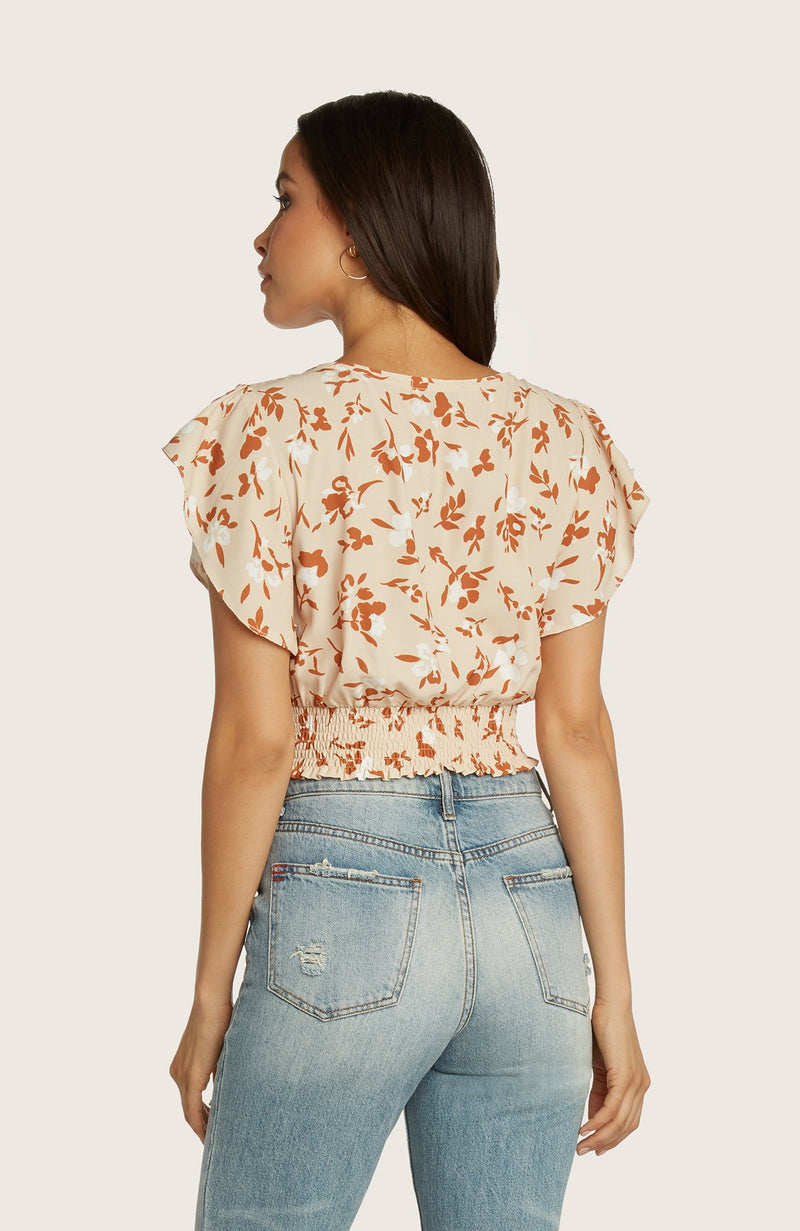 Willow-caroline-short-flutter-sleeve-top-v-neckline-waist-tie-detail-cantaloupe-orange