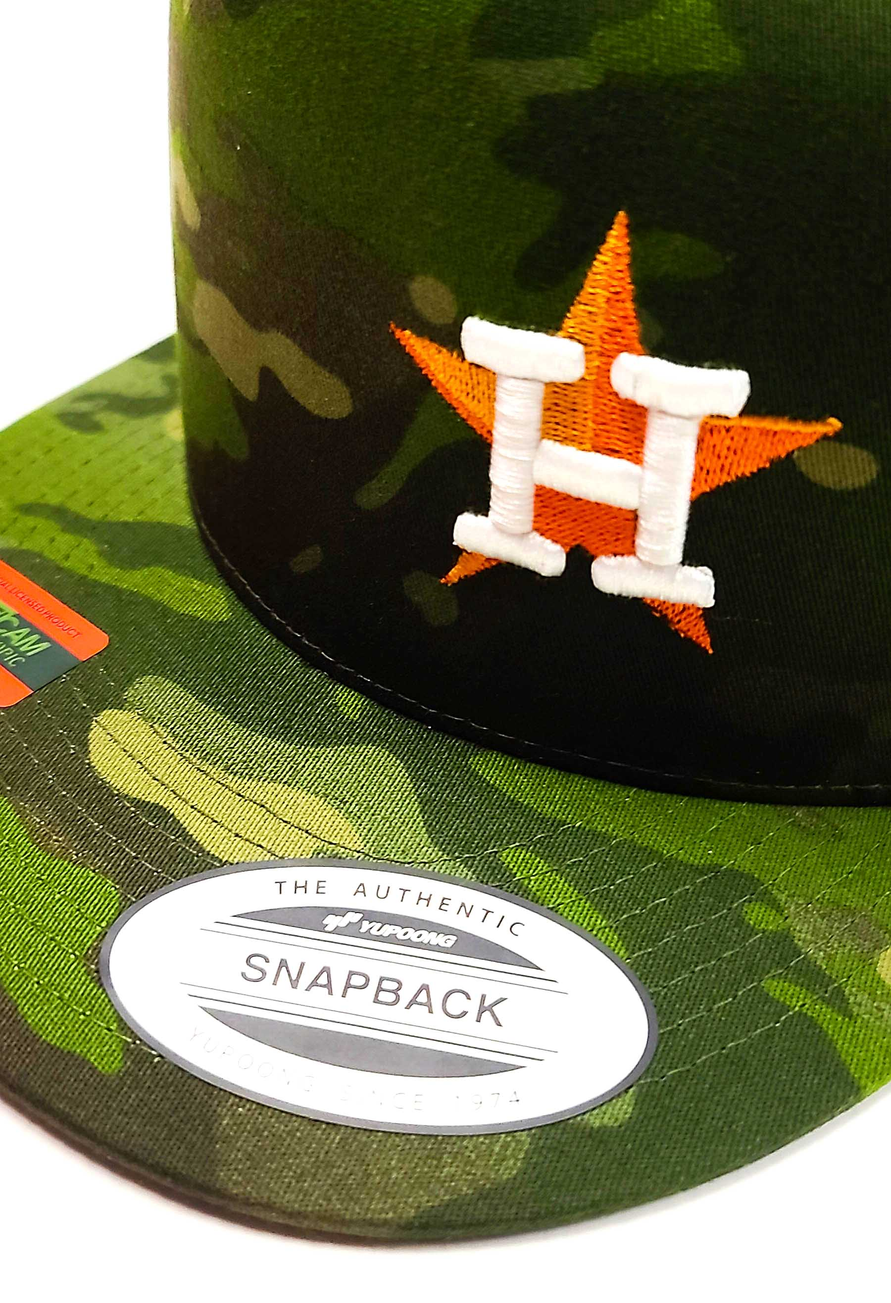 Houston Astros Star logo with the Texas flag on the side of a 5 panel Camo classic trucker cap logo view
