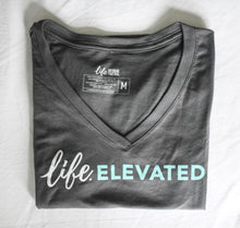 "Gray cotton T-shirts with white and blue lettering ""Life Elevated"""