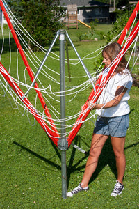 A young lady opening her Sunshine Clothesline getting it ready to use.