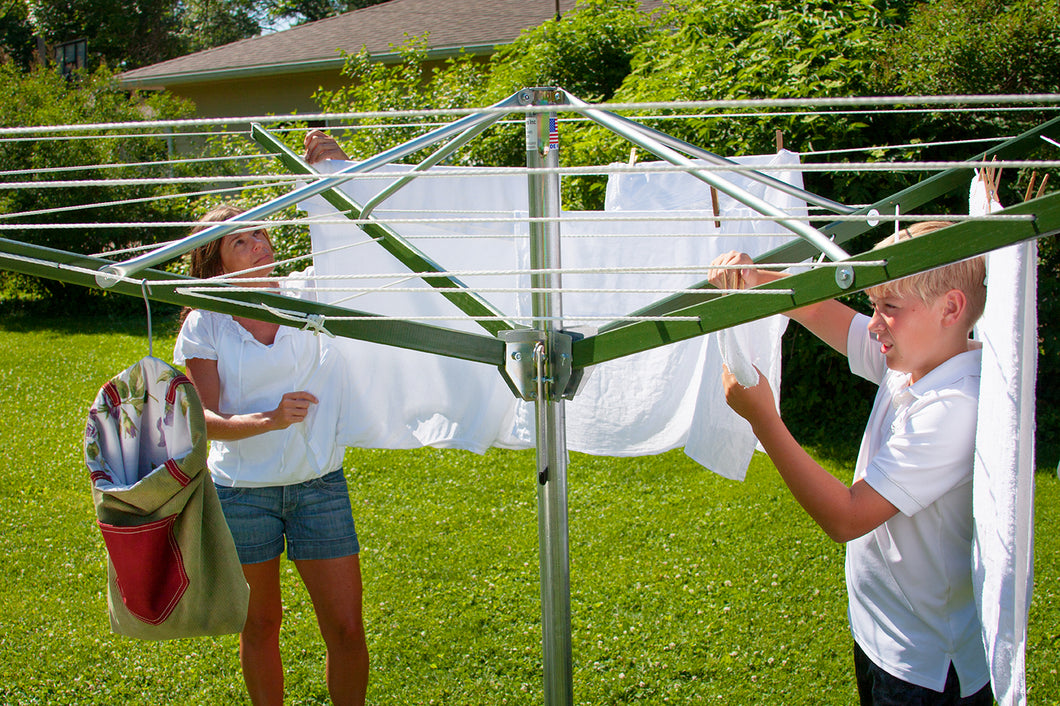 Mom and son hanging clothes on a Deluxe DS9 Sunshine Clothesline
