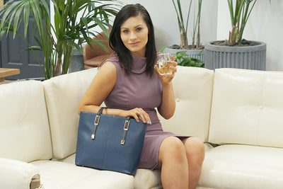 Stylish blue wine purse with hidden reservoir for wine